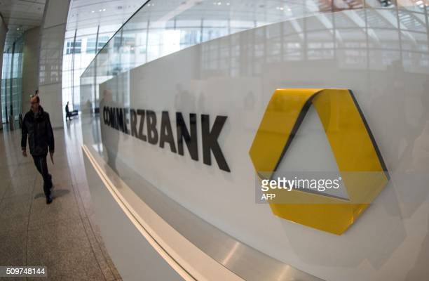 A man walks past the logo of Germany's second biggest bank Commerzbank at the company's headquarters where is taking place Commerzbank's annual press...