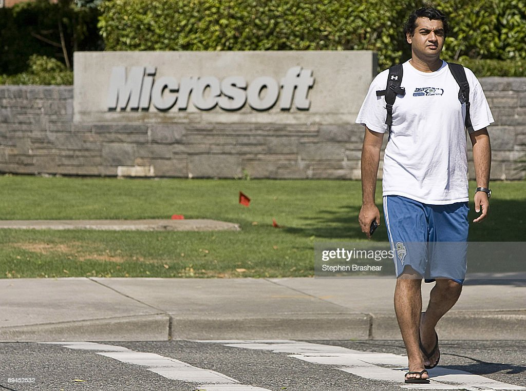 A man walks past the main campus of Microsoft headquarters July 29, 2009 in Redmond, Washington. Microsoft and Yahoo! have announced a 10-year internet search partnership in an attempt to take away users from search giant Google.