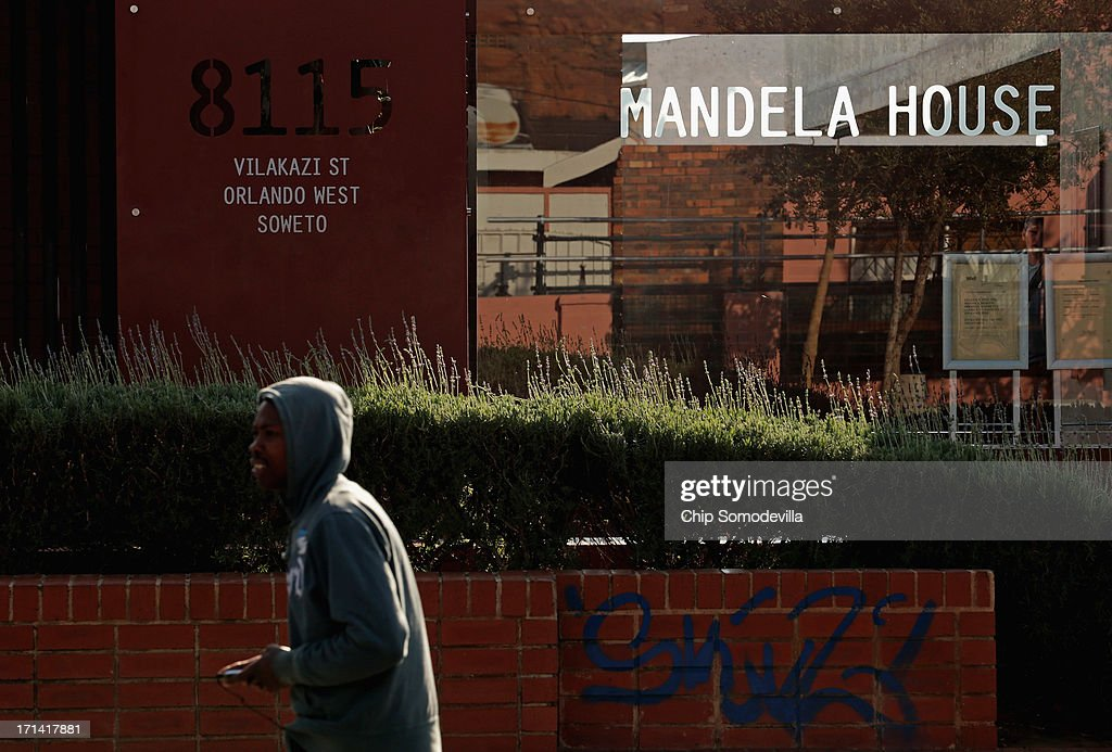 A man walks past the Mandela House Museum, where former President Nelson Mandela lived in Soweto from 1946 to 1962, June 24, 2013 in Johannesburg, South Africa. South African President Jacob Zuma confirmed that Mandela's condition has become critical since he was admitted to the hospital over two weeks ago for a recurring lung infection.