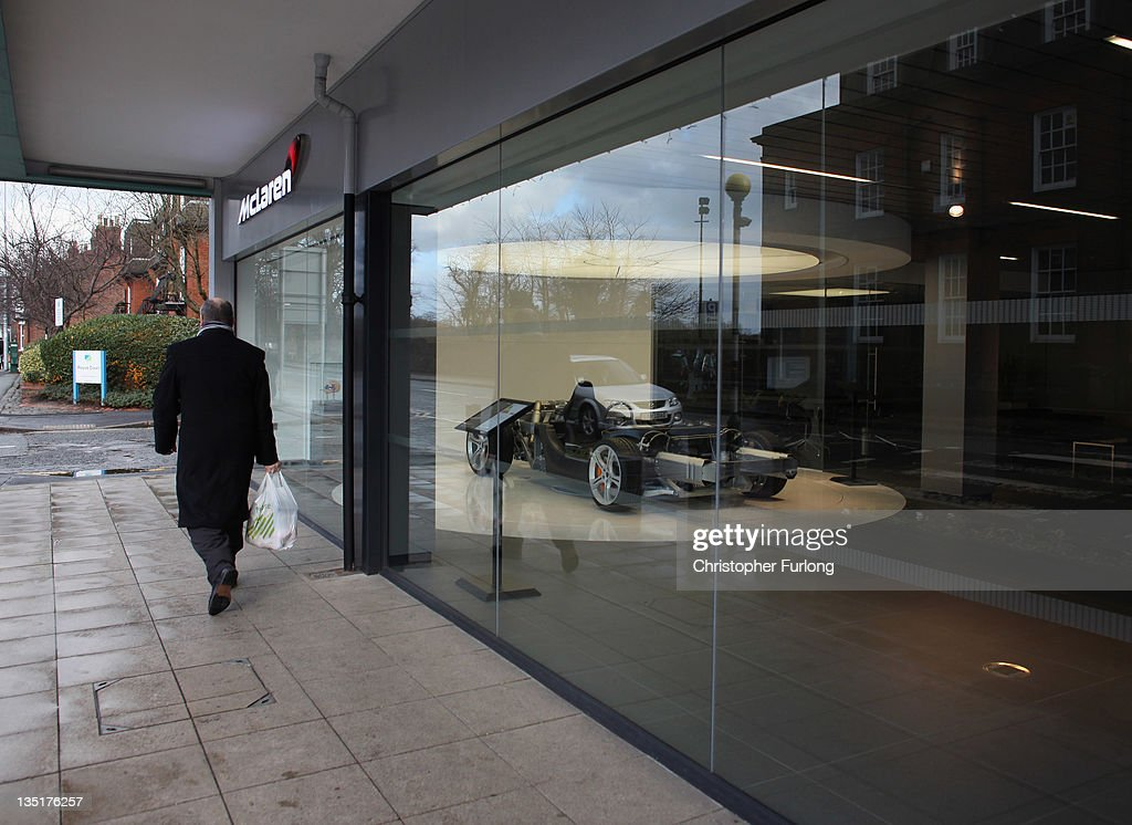 A man walks past the McLaren super car showroom on December 7, 2011 Knutsford, England. With a weak outlook at the start of the Christmas shopping boom, many retailers are slashing prices with the hopes of combating weak sales.