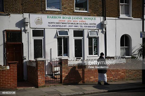 A man walks past the nearest mosque to the home where Islamic State militant Mohammed Emwazi who has come to be known as Jihadi John is believed to...