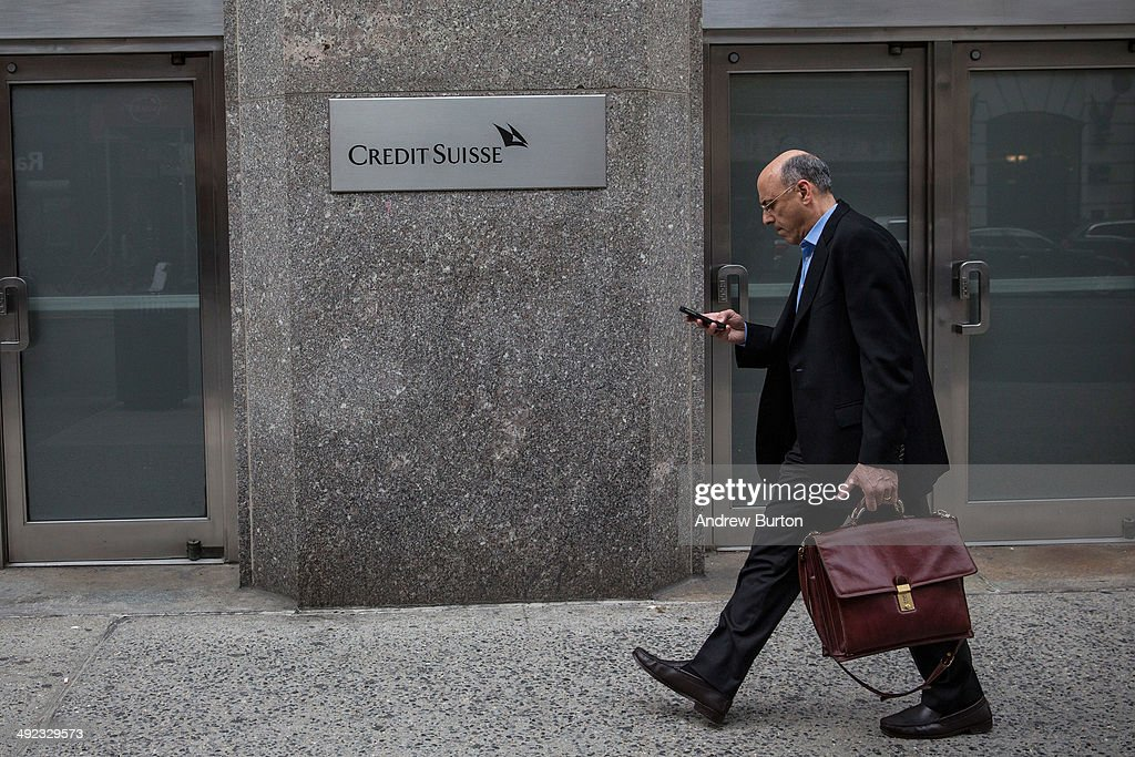 A man walks past the New York offices of Credit Suisse on May 19 2014 in New York City Credit Suisse is expected to plead guilty to one count of...