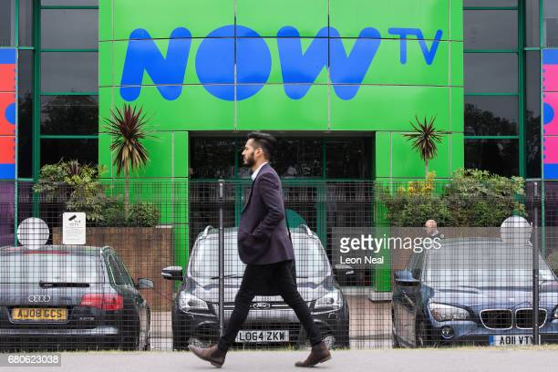 A man walks past the Now TV building at the SKY headquarters in Isleworth on May 9 2017 in London England The independent communications regulator...