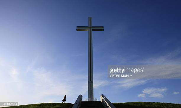 A man walks past the Papal Cross which was built for the visit of the late Pope John Paul II in September 1979 in Phoenix Park in Dublin Ireland on...
