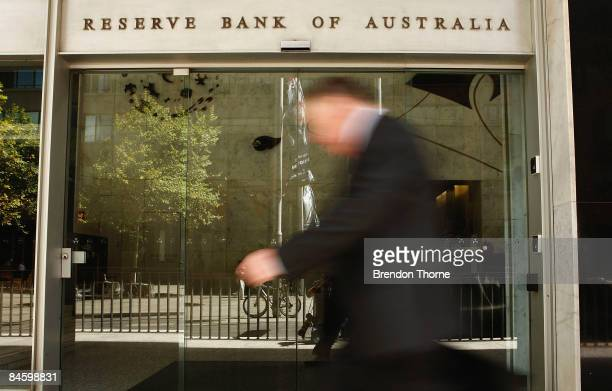 A man walks past the RBA sign in Sydney as economists wait to see if The Reserve Bank of Australia will cut official interest rates today at the...