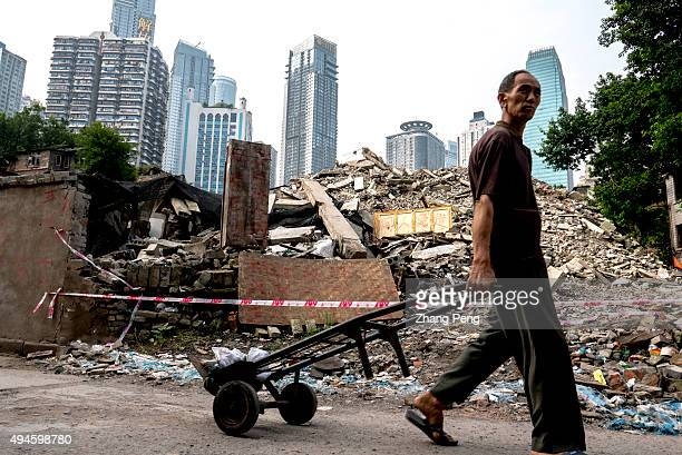 A man walks past the ruins of Shibati an old city area near Jiefangbei Shibati characteristic of ladder streets and traditional architectures along...