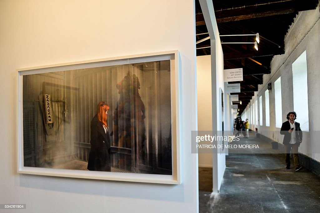 A man walks past the Spanish gallery 'Maisterravalbuena' stand during the ARCO Lisbon Contemporary Art Fair in Lisbon on May 25, 2016. ARCO will be open to the public from May 26 to 29. / AFP / PATRICIA
