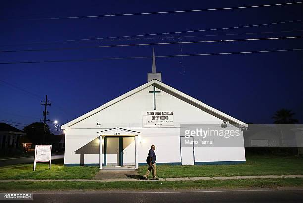 A man walks past the Trinity United Missionary Baptist Church in the Upper Ninth Ward on August 27 2015 in New Orleans Louisiana President Obama...