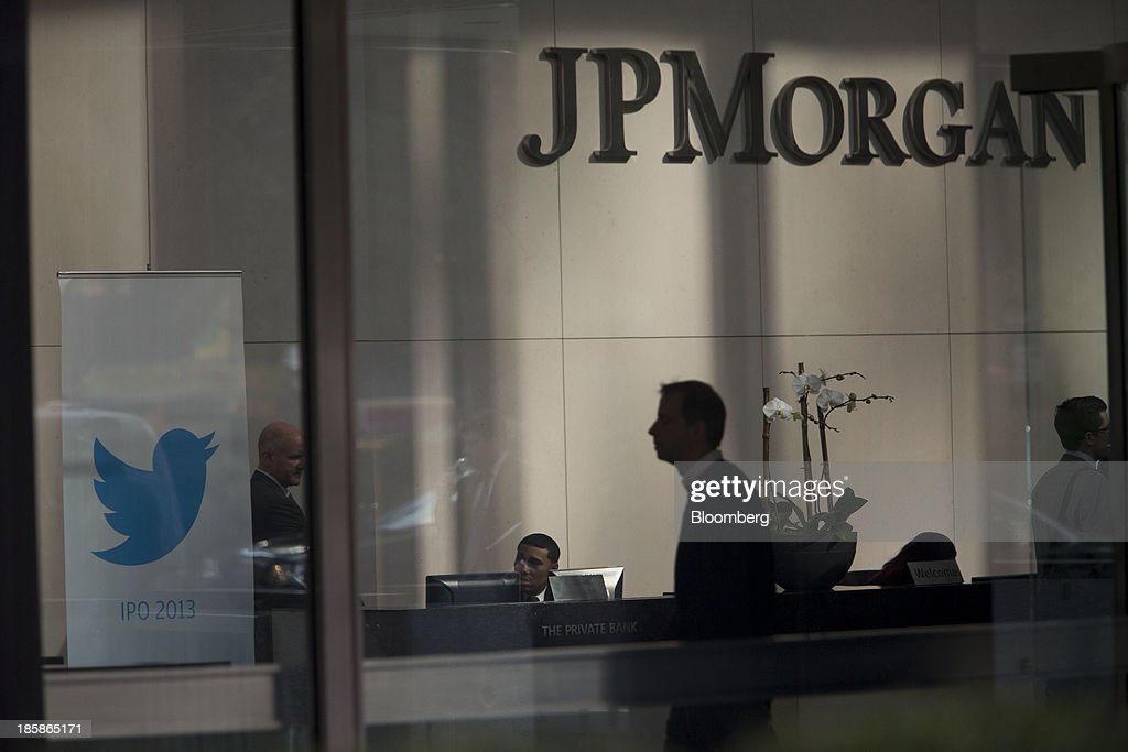 A man walks past the Twitter Inc. logo displayed in the lobby of JPMorgan Chase & Co. headquarters in New York, U.S., on Friday, Oct. 25, 2013. Twitter Inc. will make the case to potential investors in its initial public offering that it needs to keep spending to grow, and profit will come once it can reap the benefits of those investments. Photographer: Scott Eells/Bloomberg via Getty Images