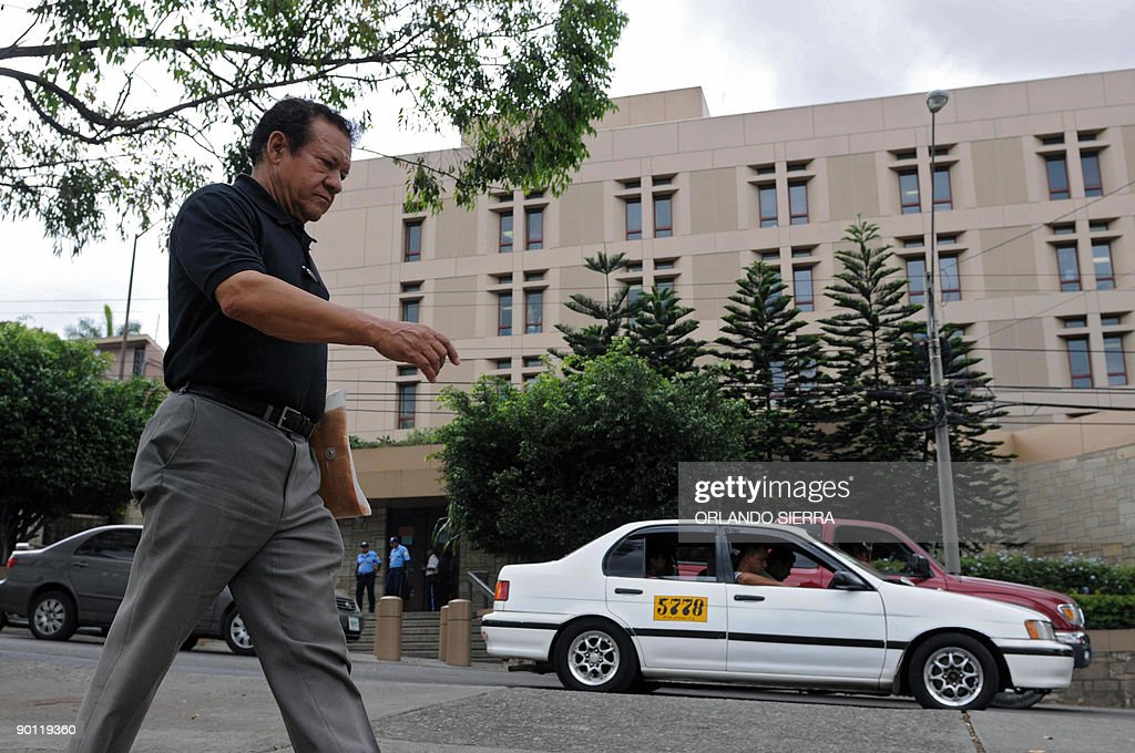 A man walks past the US Embassy in in Tegucigalpa on August 27 2009 The United States piled pressure Thursday on Honduras' coup leaders after they...