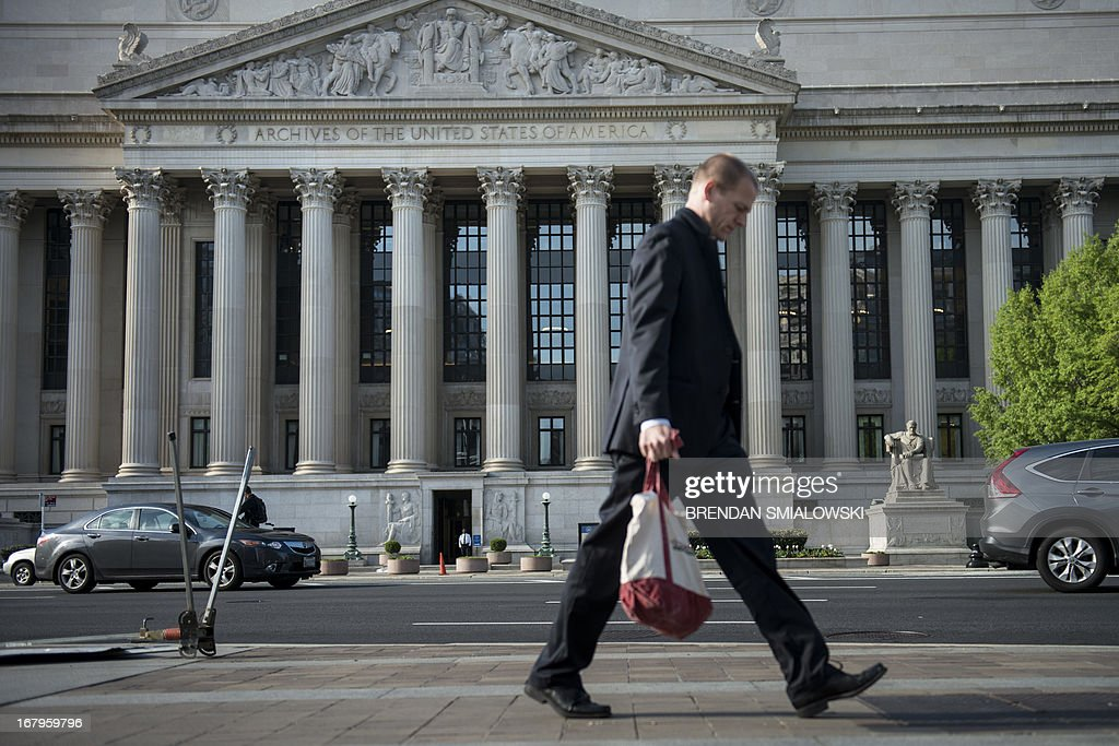 A man walks past the US National Archives and Records Administration headquarters on May 3, 2013 in Washington, DC. AFP PHOTO/Brendan SMIALOWSKI