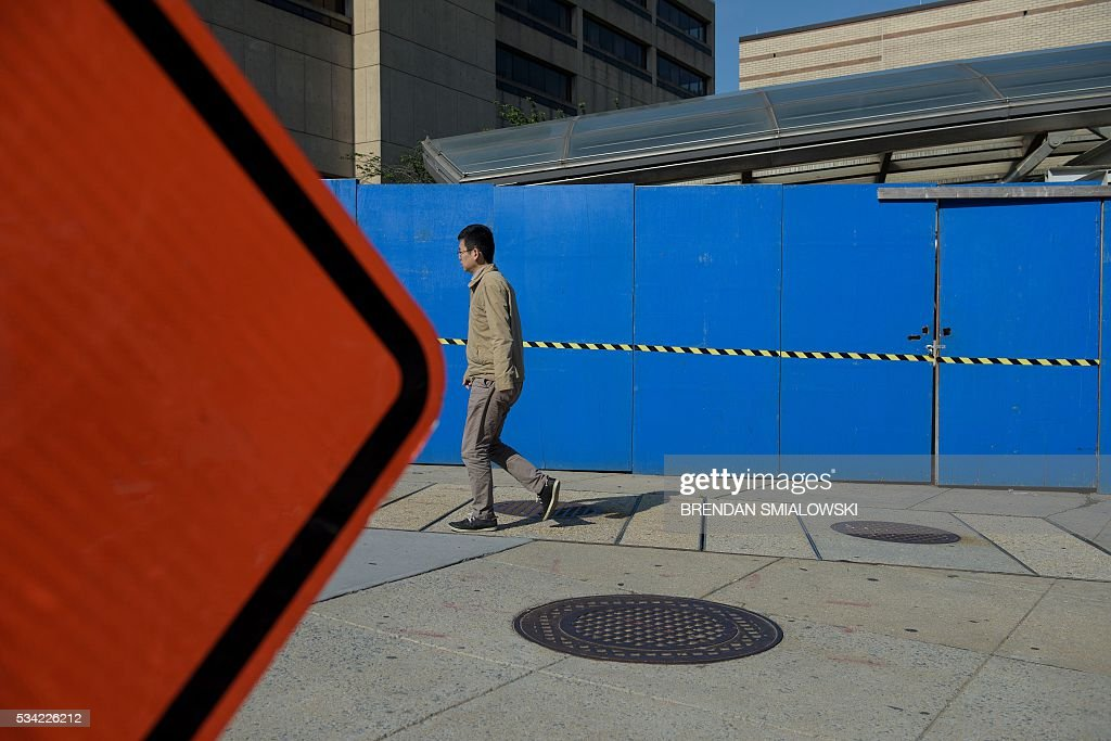 A man walks past the Van Ness UDC Metro during escalator repairs in the Metro transit system May 25, 2016 in Washington, DC. / AFP / Brendan Smialowski