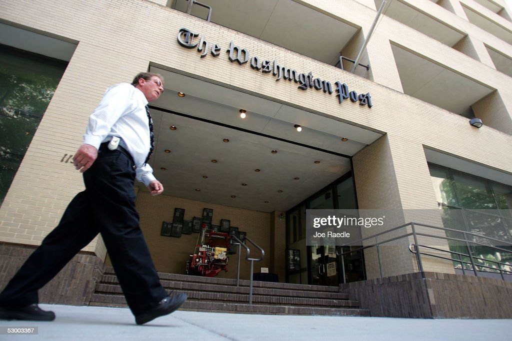 A man walks past The Washington Post building May 31, 2005 in Washington, DC. The current edition of Vanity Fair reports that retired FBI official Mark Felt was the 'Deep Throat' source who spoke to two Washington Post reporters about the Watergate scandal that forced President Richard Nixon to resign in 1974.