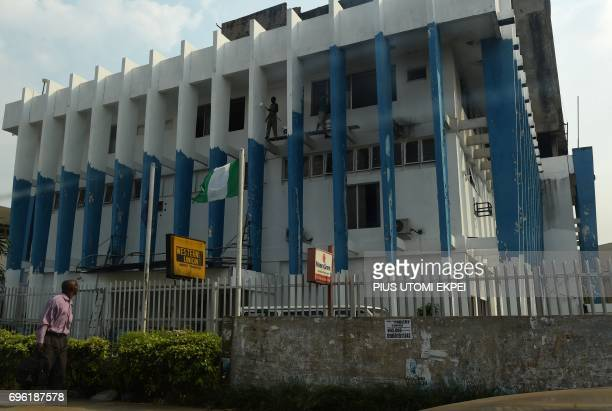 A man walks past Western Union money transfer and Moneygram in a branch of bank where beneficiaries collect money in foreign currencies repatrated by...
