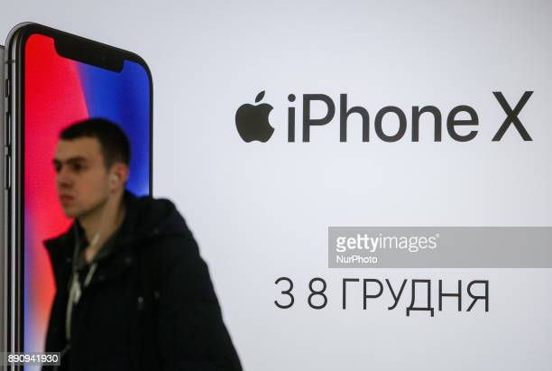 A man walks pastthe Apple promoting placard at one of shopping malls in Kyiv Ukraine Dec12 2017 iPhone X official sales started in Ukraine