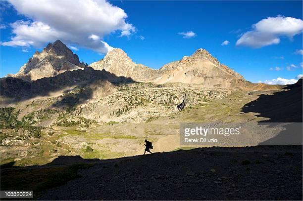 A man walks quickly through Grand Teton National Park.
