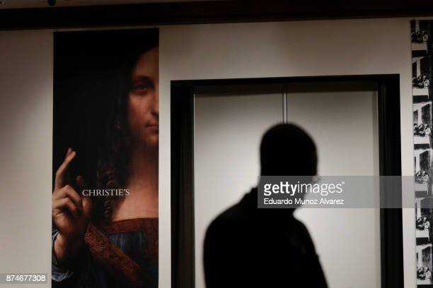 A man walks the room for the auction of Leonardo da Vinci's 'Salvator Mundi' Painting during the PostWar and Contemporary Art evening sale at...