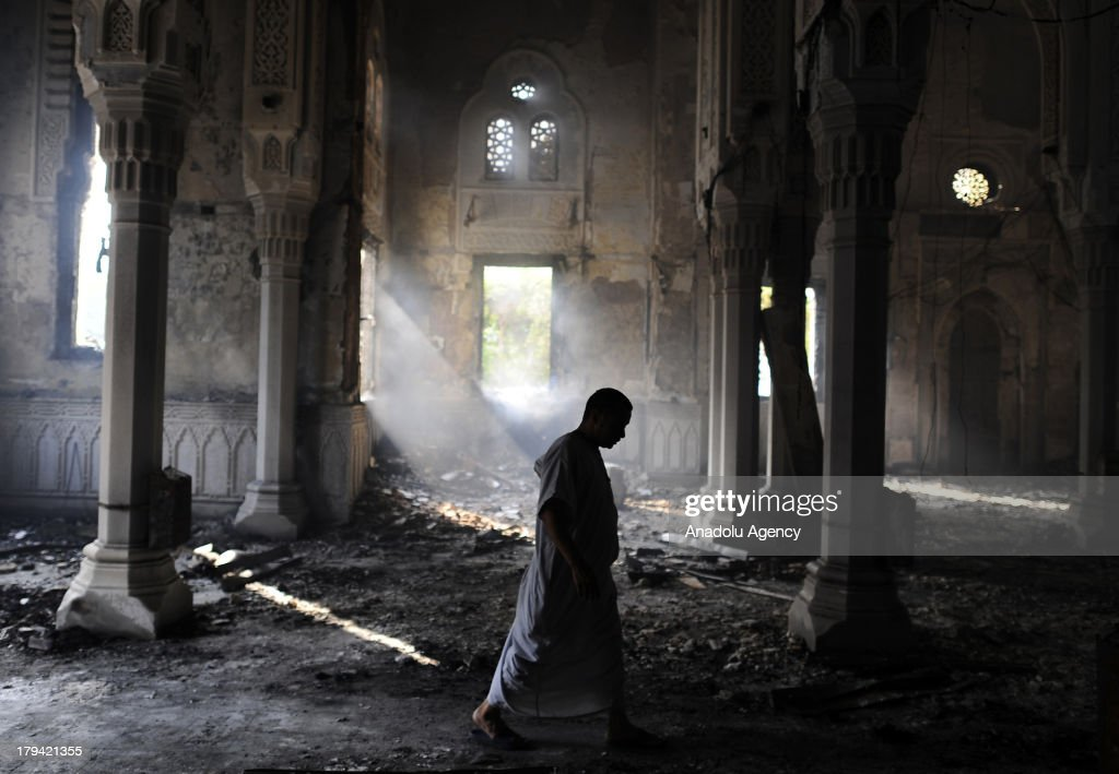 A man walks thorough the burnt out Raba'a al-Adawiya Mosque on August 15, 2013 in Raba'a al-Adawiya Square in Cairo,Egypt. The Raba'a al-Adawiya mosque burnt down as Egyptian security forces attempted to move supporters of Mohammed Morsi and the Muslim Brotherhood out of one of the biggest protest camps near the temple. Mohammed Morsi, Egypts first democratically elected president, was ousted by Egyptian army in a military coup on July 3, 2013.