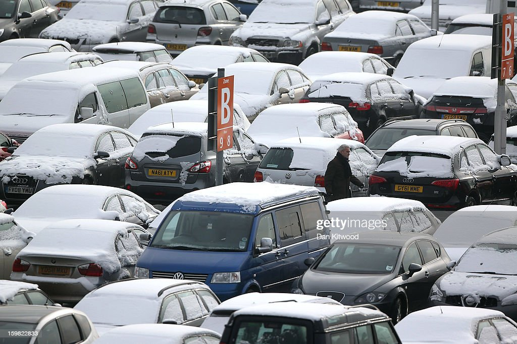 A man walks through a car park at Heathrow airport on January 21, 2013 in London, England. Around 260 flights have been cancelled today from Heathrow due to snow and poor visibility.
