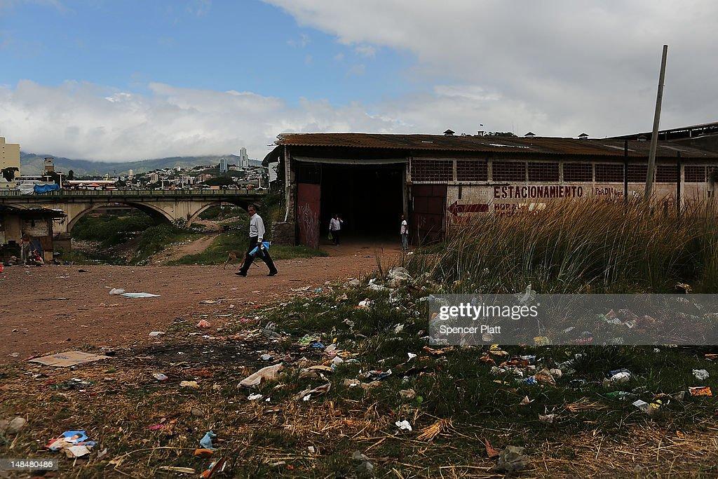 A man walks through a gang infested neighborhood on July 17 2012 in Tegucigalpa Honduras Honduras now has the highest per capita murder rate in the...
