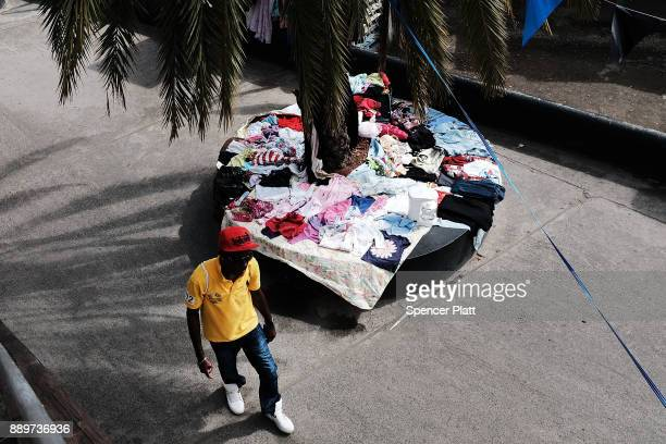 A man walks through a market on December 10 2017 in St John's Antiqua While it's sister island Barbuda was nearly destroyed in Hurricane Irma Antiqua...