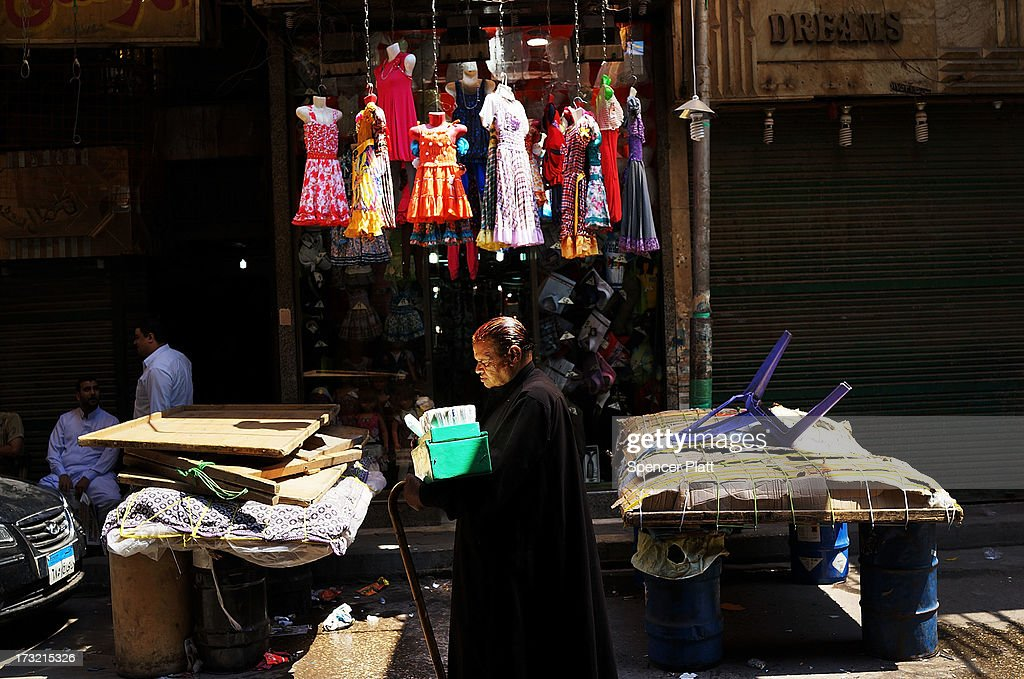 A man walks through a market on the first day of Ramadan, the sacred holy month for Muslims where many will fast from sun-up to sun-down on July 10, 2013 in Cairo, Egypt. Egypt continues to be in a state of political paralysis following the ousting of Muslim Brotherhood leader Mohamed Morsi by the military. Adly Mansour, chief justice of the Supreme Constitutional Court, was sworn in as the interim head of state in a ceremony in Cairo on the morning of July 4.