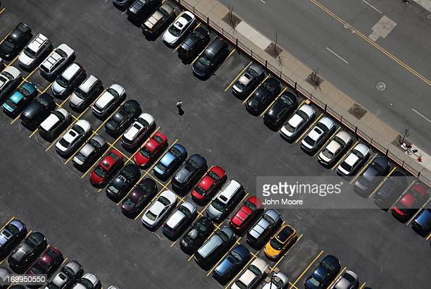 A man walks through a parking lot on June 4 2013 in Buffalo New York near the USCanada border The aerial view was seen from a helicopter flown by the...