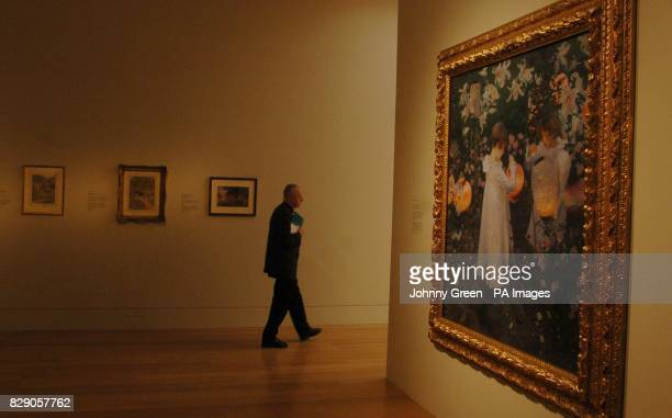 A man walks through a room housing John Singer Sargent's iconic painting 'Carnation Lily Lily Rose' painted by the artist between 188586 and now...