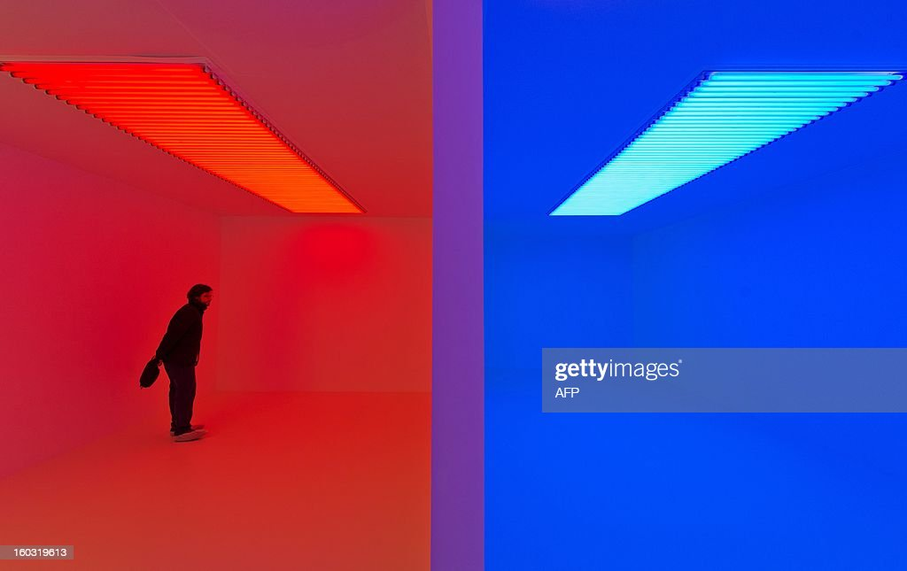 A man walks through a work entitled 'Chromosaturation' by Venezuelan artist Carlos Cruz-Diez at the 'Light Show' exhibition at the Hayward Gallery in central London on January 29, 2013. Running from January 30 to April 28 2013, the show consists of 25 installations by artists on the theme of light and it's surrounding architecture. AFP PHOTO/Leon Neal - RESTRICTED
