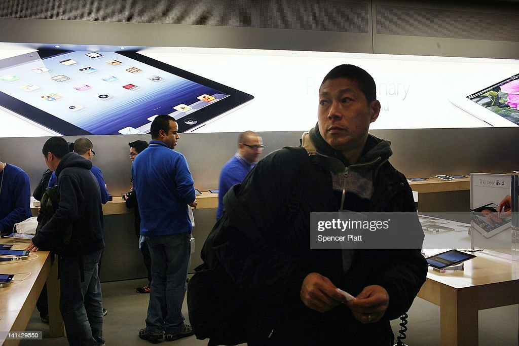 A man walks through an Apple Store on the first day the new iPads went on sale around the world March 16, 2012 in New York City. Simply called the iPad, the new tablet replaces the iPad 2 and features a high-pixel-count 'retina display.' Hundreds of people waited in line all night to be the first into the flagship Apple Store on Manhattan's Fifth Avenue.