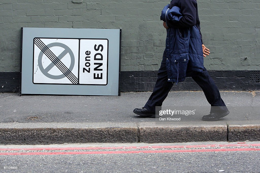 A man walks through an area of South London within a few miles of Parliament, more affluent pockets of the neighbourhood are popular with MPs as a location for their second homes due to the proximity of the seat of power on May 12, 2009 in London, England. MPs have come under increasing pressure over revelations concerning their household expenses and second home allowances. Whilst the country at large experiences the effects of a deep recession there is growing unease over an apparent manipulation of a system designed to recompense MPs for costs incurred in serving their constituents.