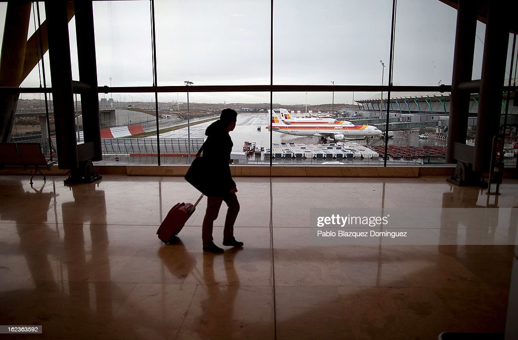 A man walks through Barajas Airport past a fleet of parked Iberia planes on February 22, 2013 in Madrid, Spain. Today is the last of a five day strike held by Iberia cabin crew, maintenance workers and ground staff in response to the planned loss of 3,800 jobs. The strike has resulted in the airline having to cancel 400 flights this week with unions planning more five day strikes in the following weeks.