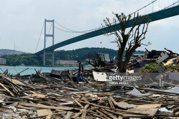 TOPSHOT A man walks through debris from the demolition of the Reina nightclub on May 22 near Bosphorus bridge in Istanbul Istanbul authorities on May...