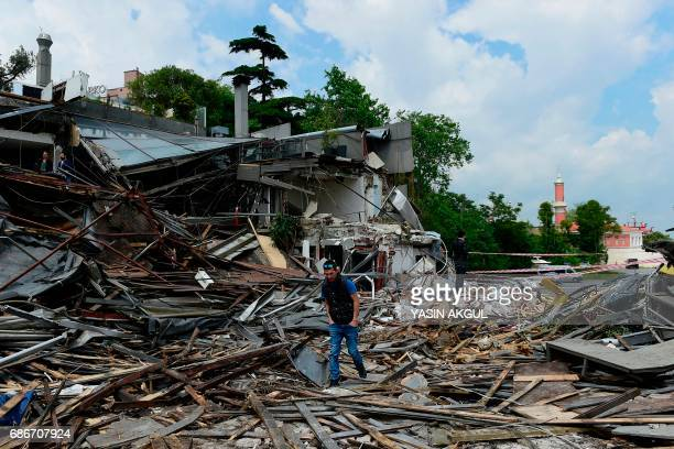 A man walks through debris from the demolition of the Reina nightclub on May 22 near Bosphorus bridge in Istanbul Istanbul authorities on May 22...