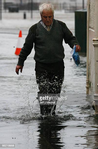 A man walks through flooding at the Whitesands area on November 19 2009 in Dumfries Scotland Much of south west Scotland and the north west of...