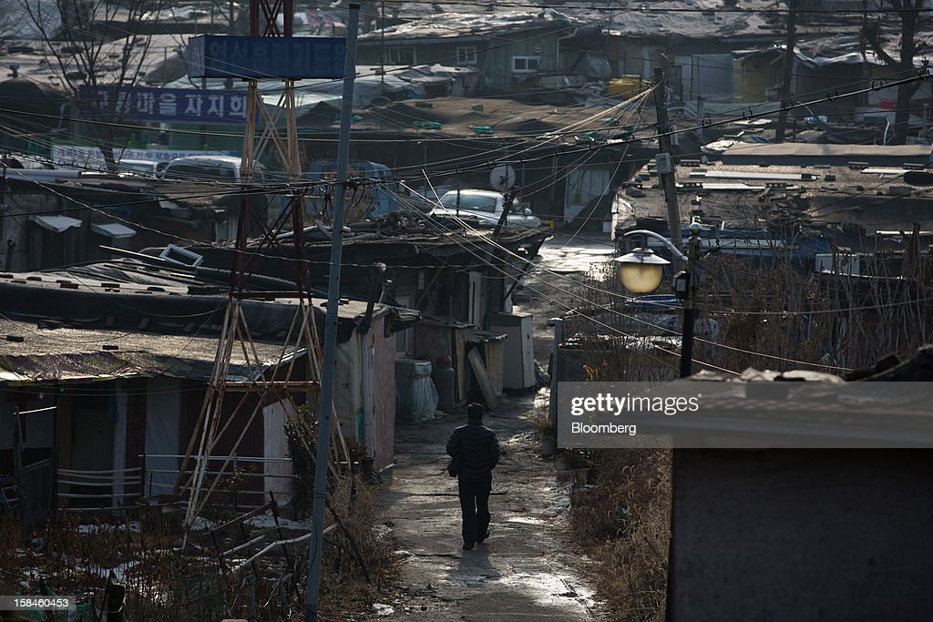 A man walks through Guryong village in the Gangnam district of Seoul, South Korea, on Sunday, Dec. 16, 2012. South Koreans vote on Dec. 19 to replace President Lee Myung Bak, whose five-year term ends in February. Photographer: SeongJoon Cho/Bloomberg via Getty Images