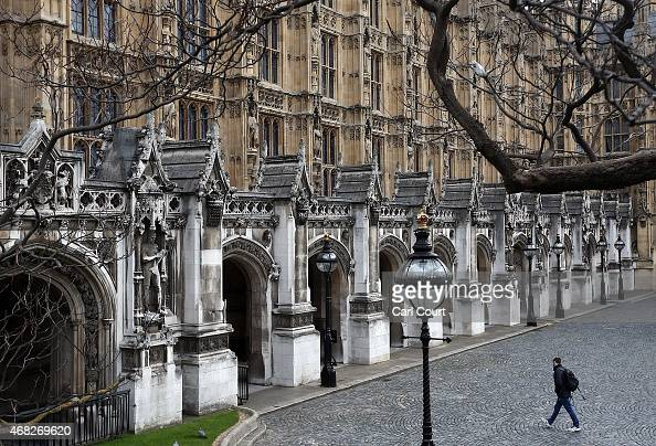 A man walks through New Palace Yard outside the House of Commons on April 1 2015 in London United Kingdom Parliament has been dissolved as...