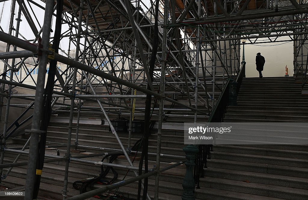 A man walks through scaffolding that supports risers for President Obama's inauguration at the U.S. Capitol, on January 13, 2013 in Washington, DC. President Barack Obama and Vice President Joe Biden will be ceremonially sworn in for a second four-year term during the 57th Inauguration on January 21.