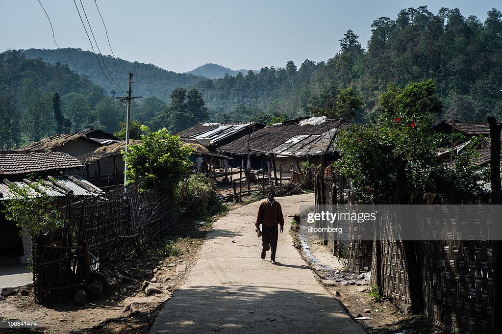 A man walks through Semadoh village, Maharashtra, India, on Thursday, Nov. 15, 2012. The Indian economy will expand 4.9 percent in 2012, the least in a decade, according to the International Monetary Fund. Photographer: Sanjit Das/Bloomberg via Getty Images
