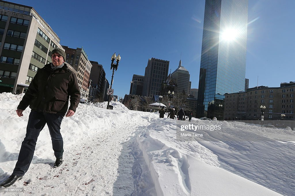 A man walks through snow in the Back Bay neighborhood following a powerful blizzard on February 10, 2013 in Boston, Massachusetts. The storm dumped more than two feet of snow in parts of New England and more than 200,000 Massachusetts customers remain without power.