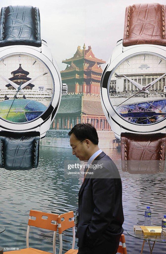 A man walks through the Beijing Watch Factory Co Limited stand at the Hong Kong Watch And Clock Fair on September 4, 2013 in Hong Kong, Hong Kong.
