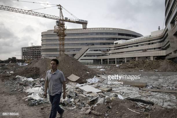 A man walks through the construction site of the Evergrande International Hospital inside the Hainan Boao Lecheng...