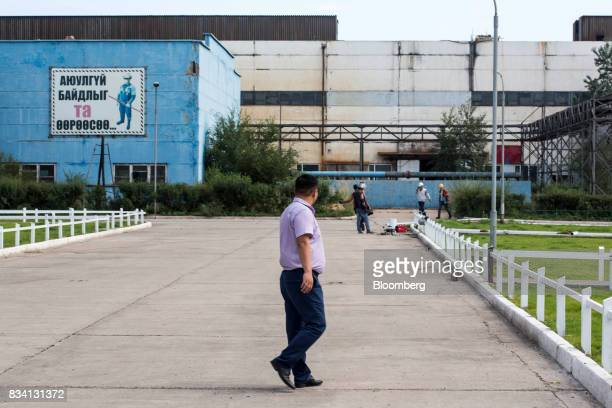 A man walks through the Darkhan Metallurgical Plant in Darkhan Mongolia on Monday Aug 14 2017 Mongolia desperate to make more of its abundant...