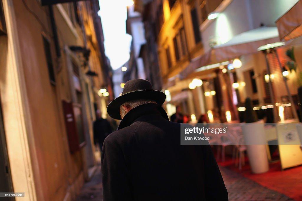 A man walks through the fashionable Via Condotti shopping area near the Spanish Steps on March 27, 2013 in Rome, Italy.