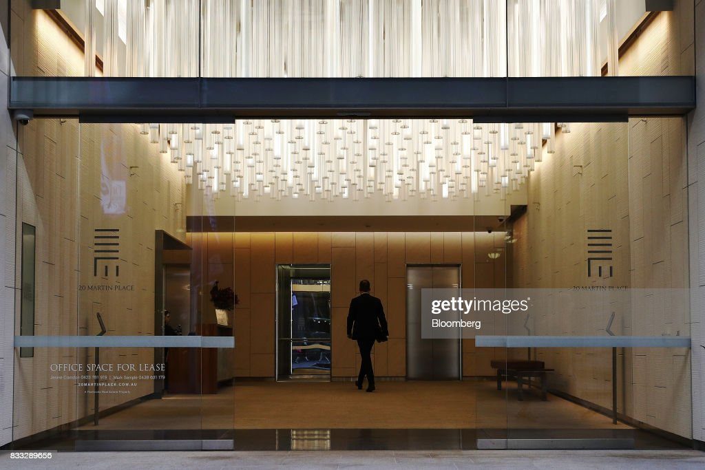 A man walks through the foyer of the 20 Martin Place building in Sydney, Australia, on Thursday, Aug. 17, 2017. Australian employers added more jobs than forecast in July, underscoring the central banks confidence in an improving labor market. Photographer: Brendon Thorne/Bloomberg via Getty Images