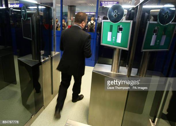 A man walks through the new facial recognition system at Manchester Airport