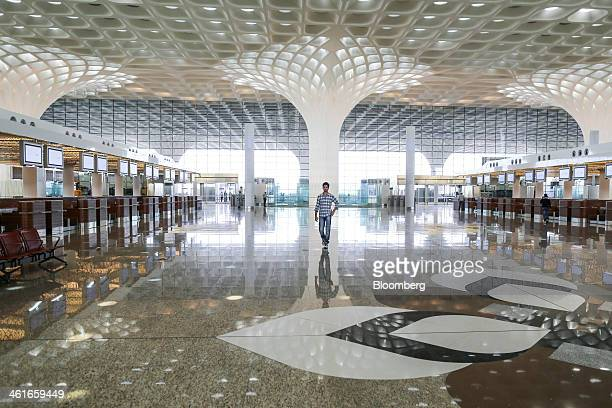 A man walks through the newly built Terminal 2 of the Chhatrapati Shivaji International Airport operated by GVK Power Infrastructure Ltd in Mumbai...