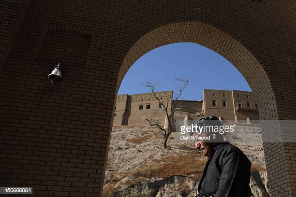 A man walks through the Qaysari Market next to the ancient Citadel on June 15 2014 in Erbil Iraq The Citadel is thought to be the oldest continuously...