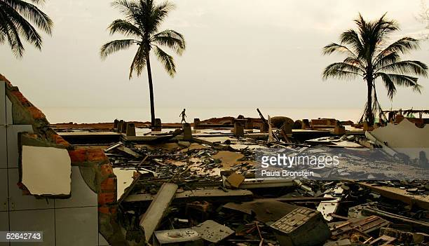 A man walks through the rubble and debris still left untouched at the Mukdara Beach resort April 17 2005 in Khao Lak Thailand Hundreds of foreigners...