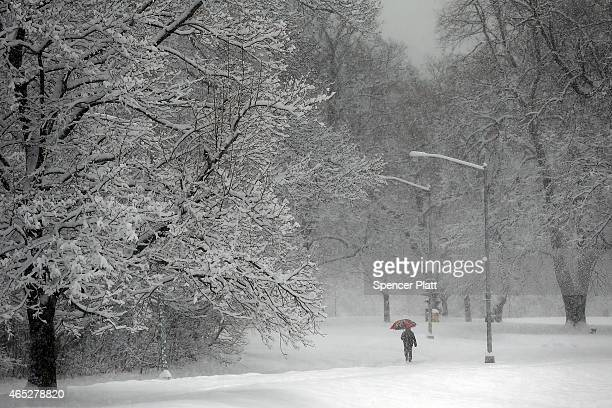 A man walks through the snow in Prospect Park in Brooklyn on March 5 2015 in New York City New York City and much of the Northeast is experiencing...